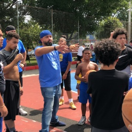 Edwin Desamour, community leader, divides neighborhood youth into teams for the game.
